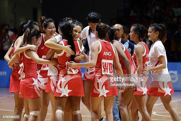 Team Singapore celebrate after defeating Malaysia in the women's netball gold medal match at the OCBC Arena Hall during the 2015 SEA Games on June 7...
