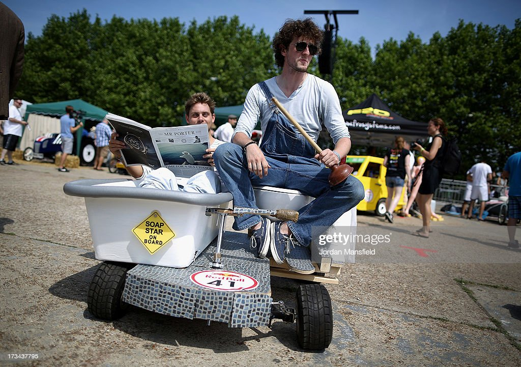 A team sit with their soapbox racer ahead of the start of the Red Bull Saopbox Race at Alexandra Palace on July 14, 2013 in London, England. The Red Bull Soapbox Race returned to London after nine years and encourages competitors to build and race their own homemade soapboxes down a hill.