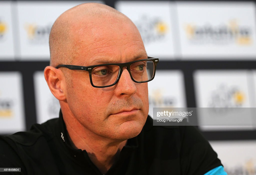 Team Sky General Manager Sir <a gi-track='captionPersonalityLinkClicked' href=/galleries/search?phrase=Dave+Brailsford&family=editorial&specificpeople=3000000 ng-click='$event.stopPropagation()'>Dave Brailsford</a> of Great Britian addresses the media during a press conference prior to the 2014 Le Tour de France on July 3, 2014 in Leeds, United Kingdom.