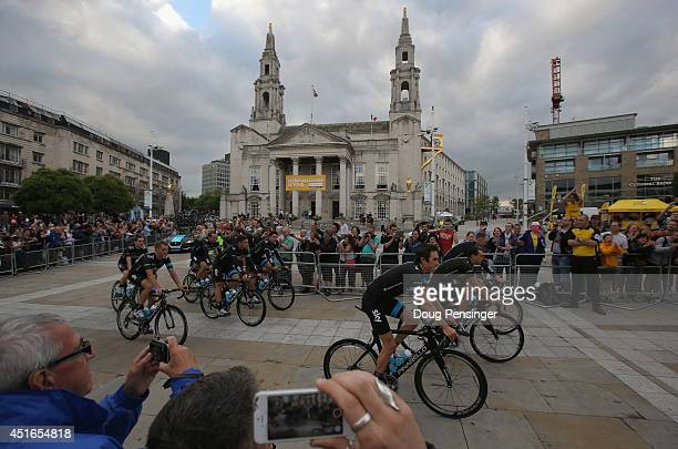 Team Sky is greeted by supporters as they ride through Millenium Square enroute to the Team Presentation prior to the 2014 Le Tour de France on July...