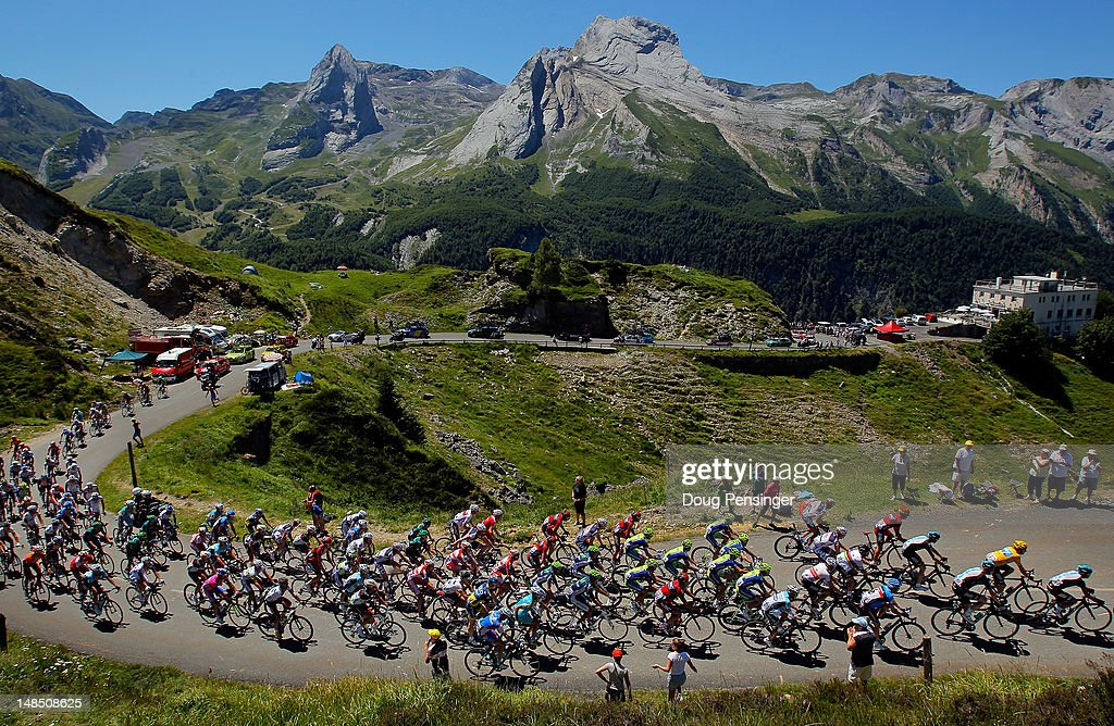 Team Sky Procycling leads the peloton on the climb of the Col d'Aubisque as they defend the race leader's yellow jersey for <a gi-track='captionPersonalityLinkClicked' href=/galleries/search?phrase=Bradley+Wiggins&family=editorial&specificpeople=182490 ng-click='$event.stopPropagation()'>Bradley Wiggins</a> (2R) of Great Britain, during stage sixteen of the 2012 Tour de France from Pau to Bagneres-de-Luchon on July 18, 2012 in Gourette, France.