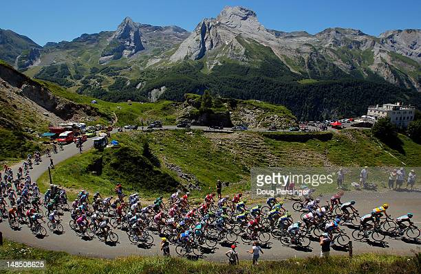 Team Sky Procycling leads the peloton on the climb of the Col d'Aubisque as they defend the race leader's yellow jersey for Bradley Wiggins of Great...