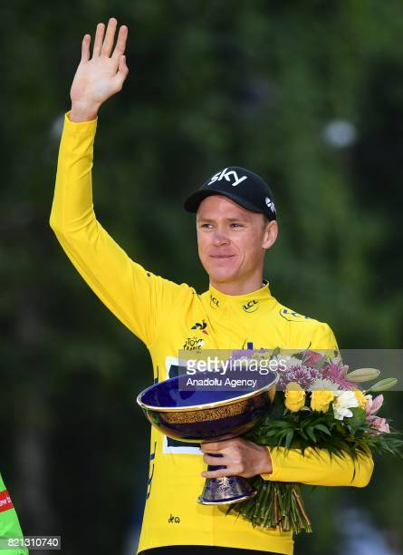 Team Sky rider Christopher Froome of Great Britain celebrates on the podium after winning the Tour de France 2017 cycling race at the Avenue des...