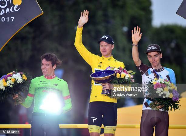 Team Sky rider Christopher Froome of Great Britain Rigoberto Uran of Colombia and Romain Bardet of France celebrate on the podium after winning the...