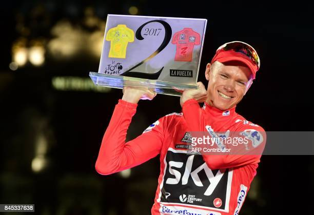 Team Sky's British cyclist Chris Froome celebrates on the podium winning the 72nd edition of 'La Vuelta' Tour of Spain cycling race in Madrid on...