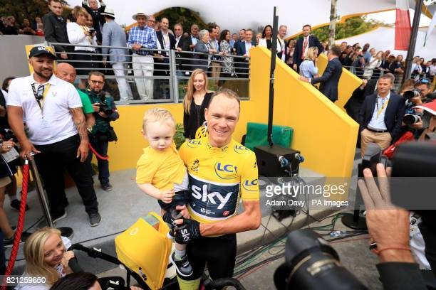 Team Sky's Chris Froome celebrates victory with his son Kellan after stage 21 of the Tour de France in Paris France