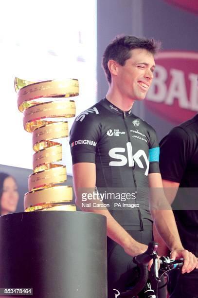 Team Sky's Philip Deignan next to the Giro D'Italia trophy during the team presentations