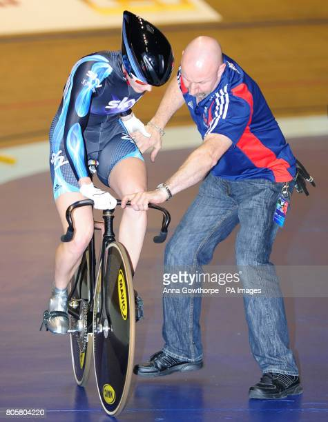 Team Sky's Victoria Pendleton is assisted in stopping her bike after completing the Women's 500m Time Trial in which she won the silver medal during...