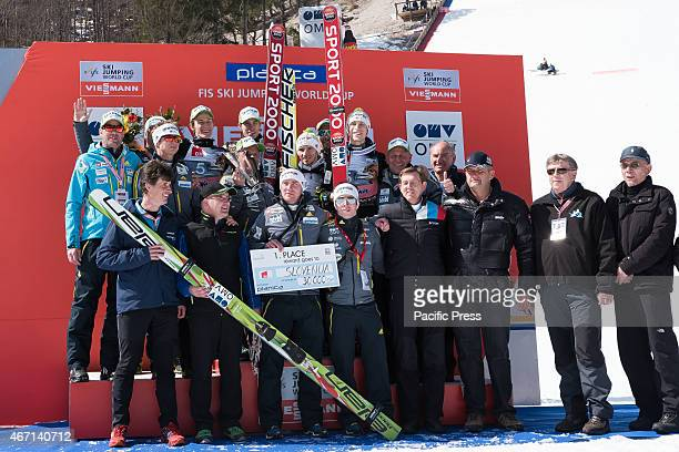 Team Slovenia coaches and Prime Minister Miroslav Cerar on the podium at FIS Word Cup Ski Jumping Team competition in Planica