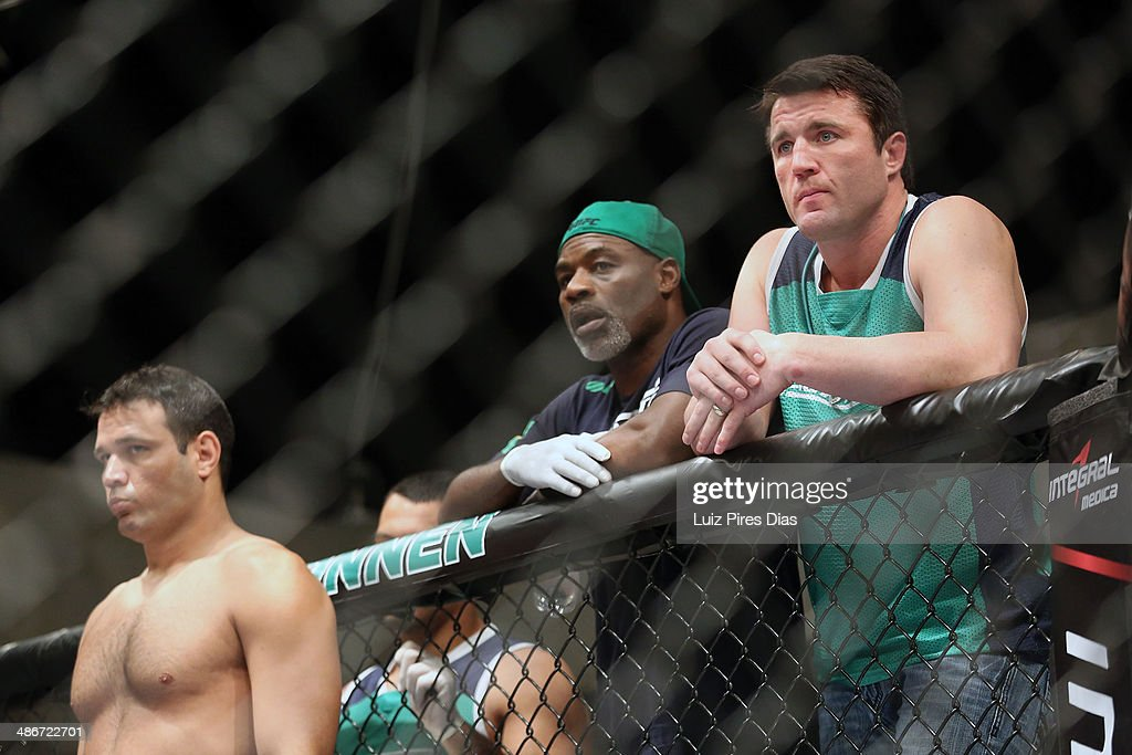 Team Sonnen fighter Job Kleber stands in his corner as Team Sonnen boxing coach Clayton Hires and coach <a gi-track='captionPersonalityLinkClicked' href=/galleries/search?phrase=Chael+Sonnen&family=editorial&specificpeople=5434559 ng-click='$event.stopPropagation()'>Chael Sonnen</a> stand above him before he faces Team Wanderlei fighter Richardson Moreira during season three of The Ultimate Fighter Brazil on January 28, 2014 in Sao Paulo, Brazil.