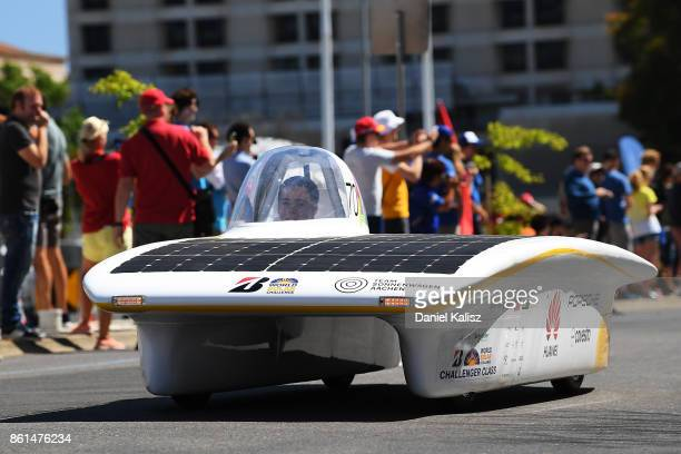Team Sonnenwagen Aachen vehicle 'HUAWEI Sonnenwagen' from Germany competes during a street parade for the 2017 Bridgestone World Solar Challenge down...