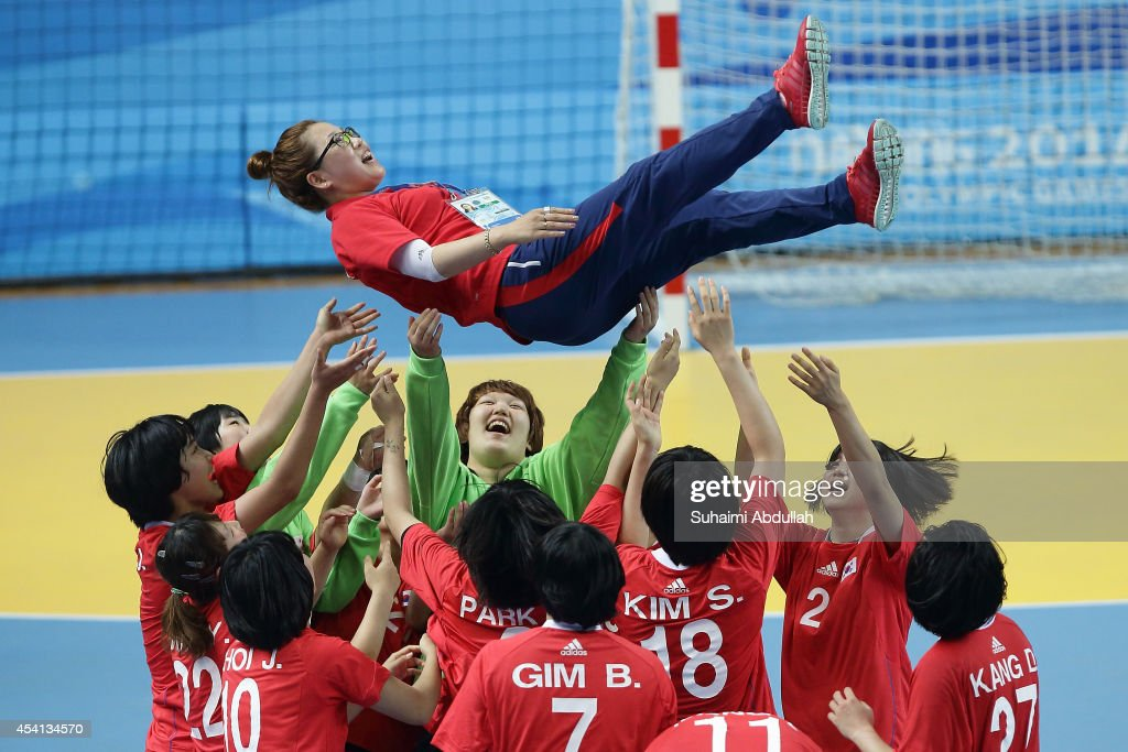 Team South Korea celebrates victtory after defeating Team Russia in the Women's Gold Medal Handball Match on day nine of Nanjing 2014 Summer Youth Olympic Games at Jiangning Sports Centre Gymnasium on August 25, 2014 in Nanjing, China.
