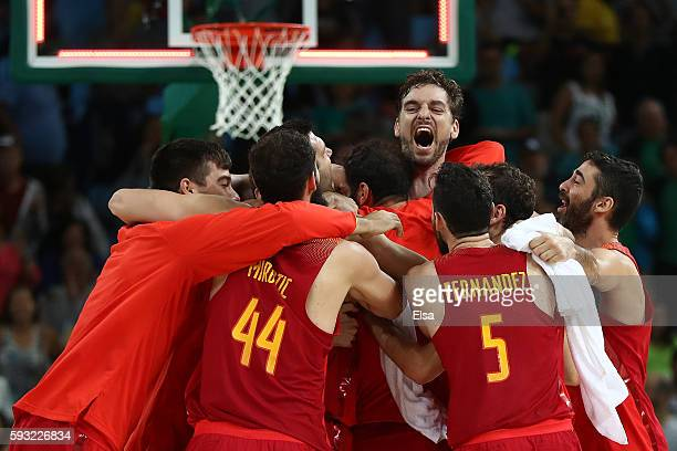 Team Spain celebrate winning the Men's Basketball Bronze medal game between Australia and Spain on Day 16 of the Rio 2016 Olympic Games at Carioca...