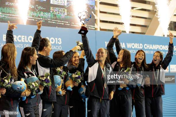 Team Spain celebrates winning the Women's Water Polo Gold Medal Match against Australia on day fourteen of the 15th FINA World Championships at...
