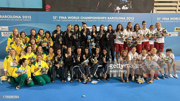 Team Spain gold medal Team Australia silver medal and team Hungary bronze medal celebrate on day fourteen of the 15th FINA World Championships at...