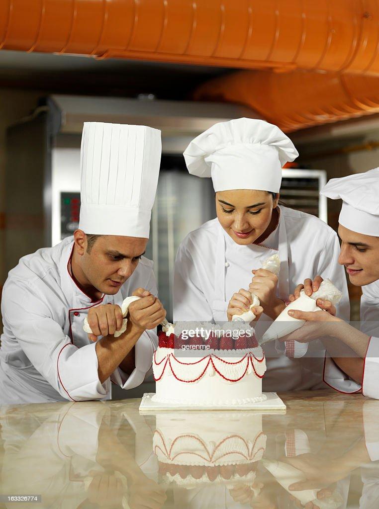 Team Spirit In The Kitchen : Stock Photo