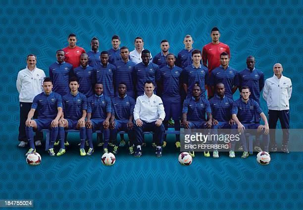 Team squad pose on October 8 2013 at the team's training base in ClairefontaineenYvelines outside Paris Florian Thauvin Morgan Sanson Hervin Ongenda...