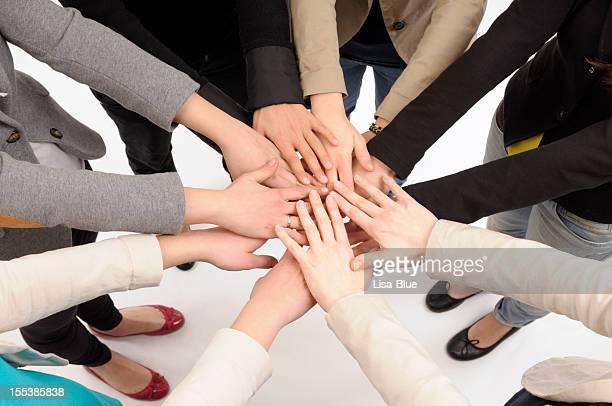 Équipe amonceler les mains