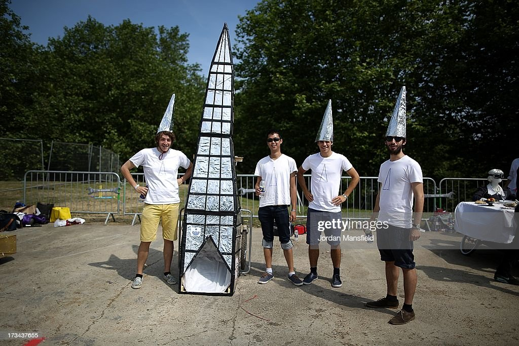 A team stand with their soapbox racer ahead of the start of the races during the Red Bull Soapbox Race at Alexandra Palace on July 14, 2013 in London, England. The Red Bull Soapbox Race returned to London after nine years and encourages competitors to build and race their own homemade soapboxes down a hill.