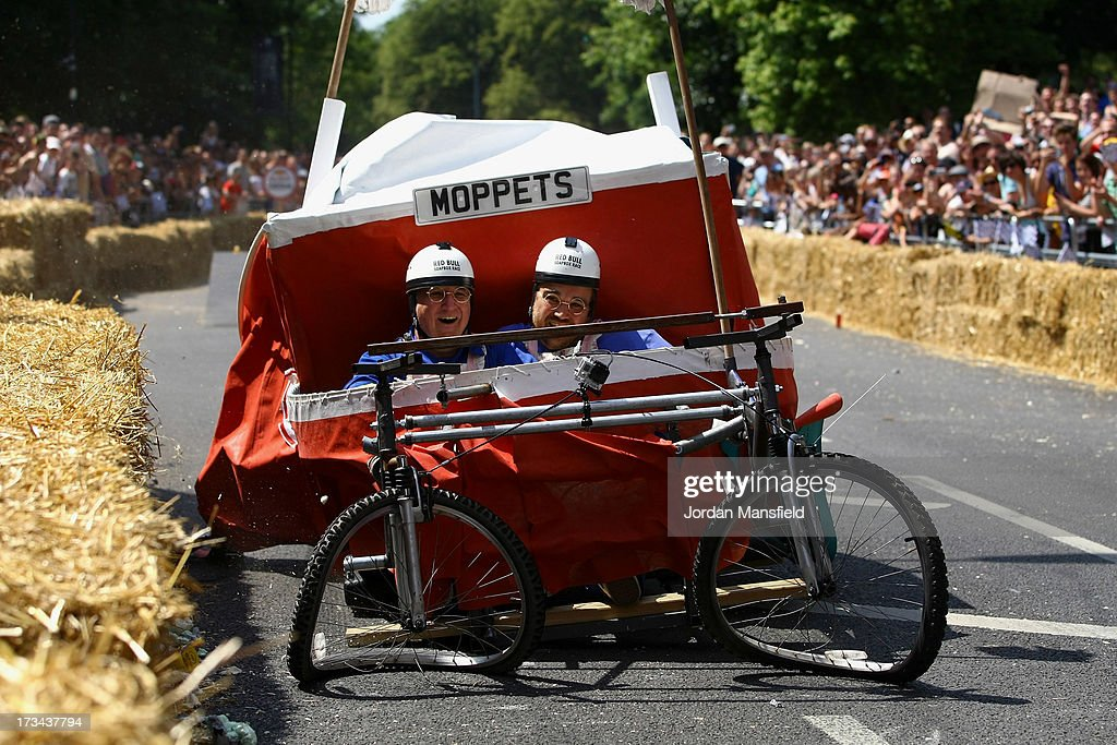 A team stop after crashing over a jump during the Red Bull Saopbox Race at Alexandra Palace on July 14, 2013 in London, England. The Red Bull Soapbox Race returned to London after nine years and encourages competitors to build and race their own homemade soapboxes down a hill.