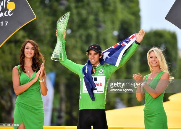 Team Sunweb rider Michael Matthews of Australia celebrates as the best sprinter on the podium after the Tour de France 2017 cycling race at the...