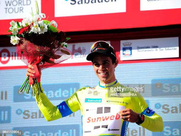 Team Sunweb's Australian rider Michael Matthews grabs his yellow jersey as he celebrates on the podium after winning the first stage of the 2017 Tour...