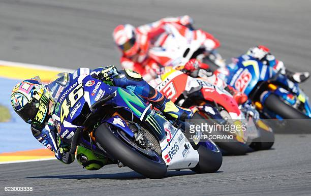 Team Suzuki ECSTAR Maverick Vinales Repsol Honda Team's Spanish rider Marc Marquez Ducati Team's Italian rider Andrea Iannone and Movistar Yamaha...