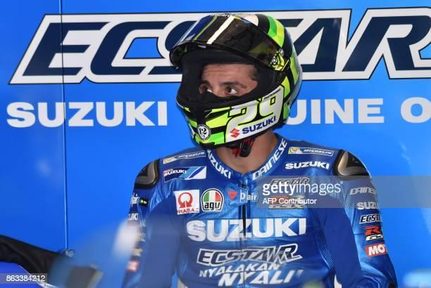 Team Suzuki Ecstar rider Andrea Iannone of Italy prepares for the second practice session of the Australian MotoGP Grand Prix at Phillip Island on...