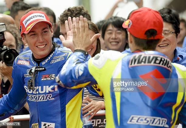 Team Suzuki Ecstar Spanish rider Aleix Espargaro celebrates his first pole position with Team Suzuki Ecstar Spanish rider Maverick Vinales second...