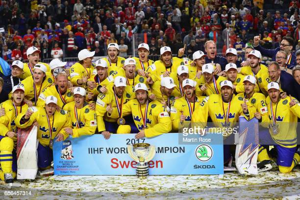 Team Sweden celebrate victory over Canada the 2017 IIHF Ice Hockey World Championship Gold Medal game Canada and Sweden at Lanxess Arena on May 21...