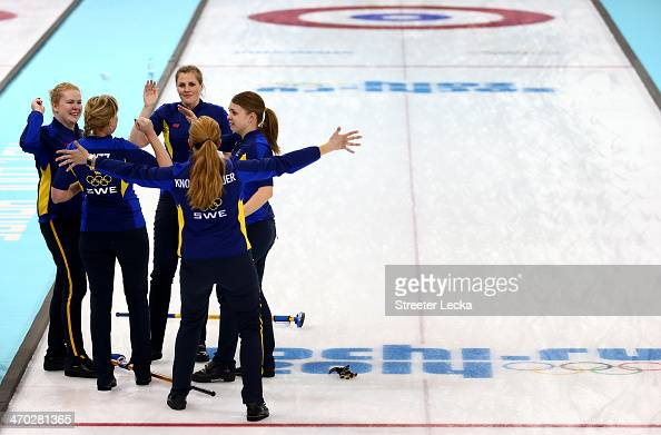 Team Sweden celebrates after defeating Switzerland during the women's curling semifinals at Ice Cube Curling Center on February 19 2014 in Sochi...