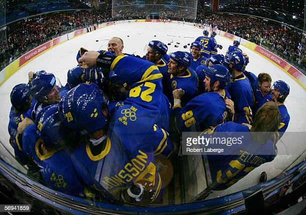 Team Sweden celebrates defeating Finland 32 to win the gold medal in the final of the men's ice hockey match between Finland and Sweden during Day 16...