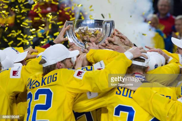 Team Sweden celebrates with the trophy after the Ice Hockey World Championship Gold medal game between Canada and Sweden at Lanxess Arena in Cologne...