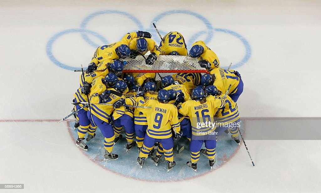 Team Sweden stand around the crease before the final of the women's ice hockey between Sweden and Canada during Day 10 of the Turin 2006 Winter Olympic Games on February 20, 2006 at the Palasport Olimpico in Turin, Italy. Canada won 4-1 to take the gold medal.