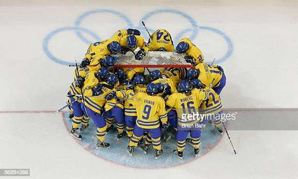 Team Sweden stand around the crease before the final of the women's ice hockey between Sweden and Canada during Day 10 of the Turin 2006 Winter...