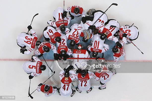 Team Switzerland huddles around the net before taking on Team USA during the ice hockey men's quarterfinal game between USA and Switzerland on day 13...