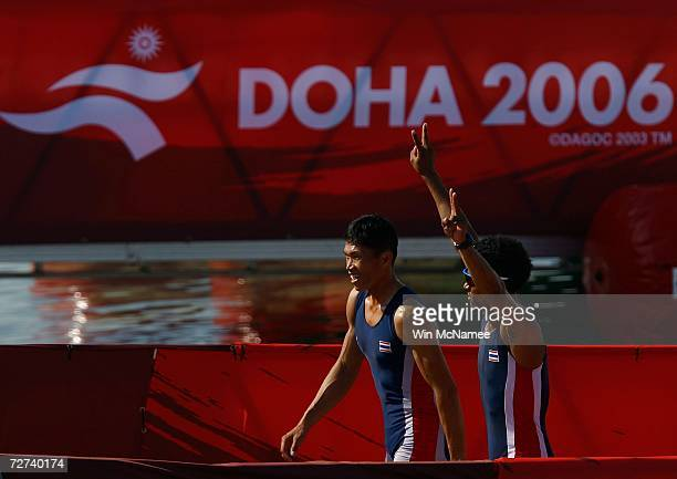 Team Thailand celebrates after winning the Silver Medal in the Men's Lightweight Double Sculls Rowing Competition during the 15th Asian Games Doha...