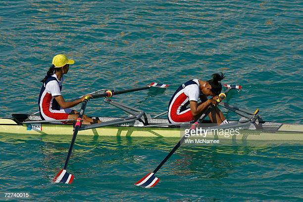 Team Thailand reacts to placing fourth in the Women's Double Sculls Rowing Competition during the 15th Asian Games Doha 2006 at the West Bay Lagoon...