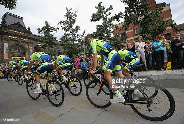 Team TinkoffSaxo is greeted by supporters as they ride through Millenium Square enroute to the Team Presentation prior to the 2014 Le Tour de France...