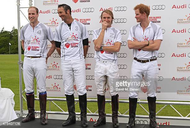 Team Ultra players Prince William Duke of Cambridge John Paul Clarkin Mark Tomlinson and Prince Harry attend day two of the Audi Polo Challenge at...