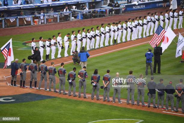 Team United States and Tean Japan stands at attention during the national anthem before Game 2 of the Championship Round of the 2017 World Baseball...