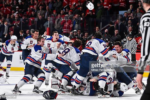 Team United States celebrate as they win gold against Canada during the 2017 IIHF World Junior Championship gold medal game at the Bell Centre on...
