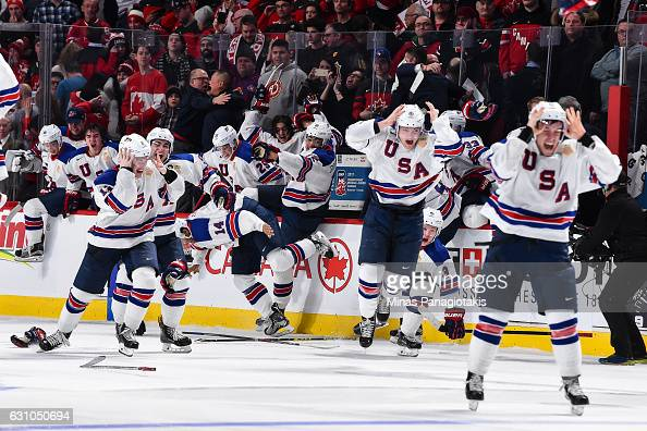 Team United States celebrate as they win gold against Team Canada during the 2017 IIHF World Junior Championship gold medal game at the Bell Centre...
