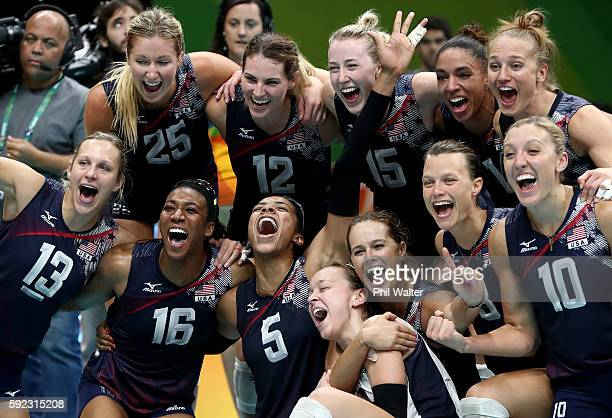 Team United States celebrates match point during the Women's Bronze Medal Match between Netherlands and the United States on Day 15 of the Rio 2016...