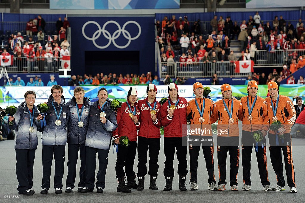 Team United States receive the silver medal, Team Canada receive the gold medal and Team Netherlands receive the bronze medal during the medal ceremony for the men's team pursuit final on day 16 of the 2010 Vancouver Winter Olympics at Richmond Olympic Oval on February 27, 2010 in Vancouver, Canada.