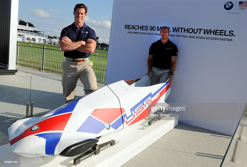 Team USA Bobsledders Steve Langton (left) and Curt Tomasevicz (right) show the two-man BMW bobsled at the BMW Experience at Conway Farms Golf Club on September 12, 2013 in Lake Forest, Illinois. BMW has paired intelligent lightweight materials with optimized aerodynamics to design a two-man bobsled for USA Bobsled & Skeleton Federation. Team USA will be equipped with a fleet of two-man BMW bobsleds to prepare them on their road to the 2014 Sochi Olympic Winter games and beyond.