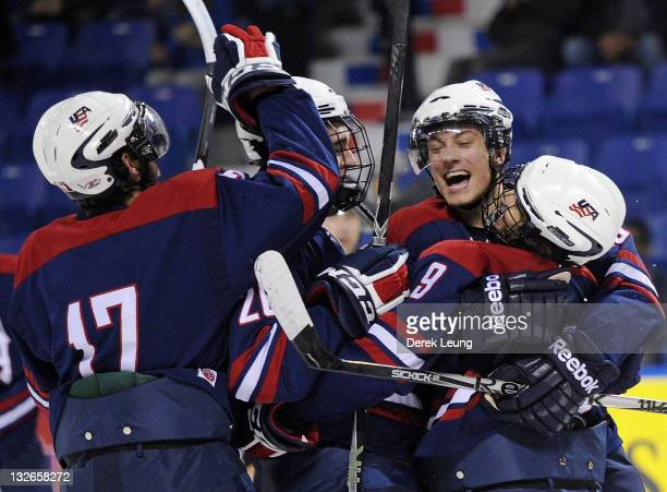 Team USA celebrates after Austin Cangelosi scored the puck on Mathias Israelsson of Sweden at World Junior A Challenge at Langley Events Center on...