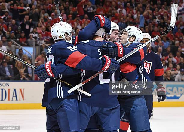 Team USA celebrates after scoring a first period goal on Team Canada during the World Cup of Hockey 2016 at Air Canada Centre on September 20 2016 in...
