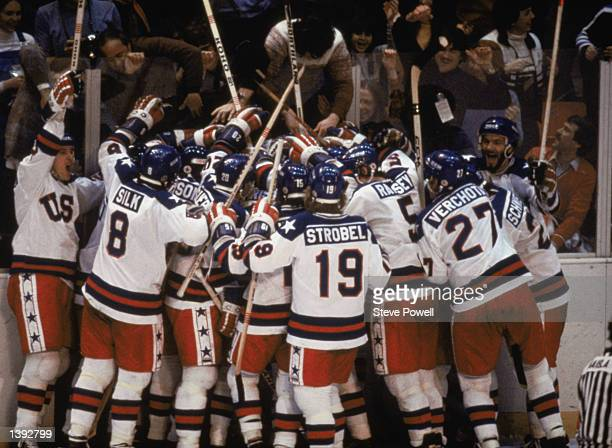 Team USA celebrates their 43 victory over the Soviet Union in the semifinal Men's Ice Hockey event at the Winter Olympic Games in Lake Placid New...