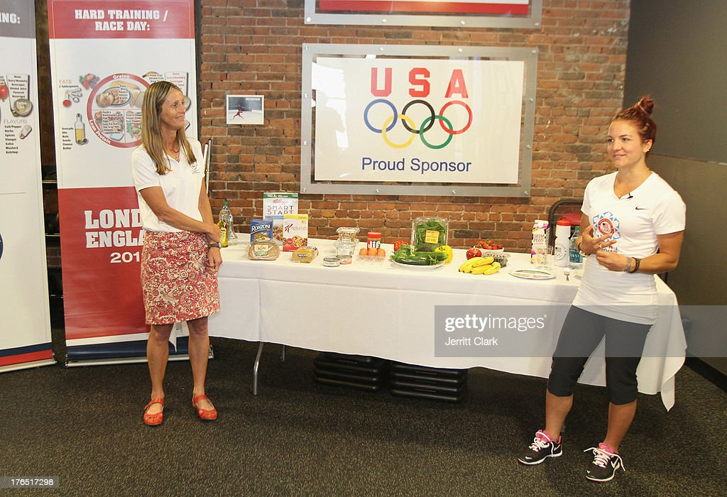 Team USA Dietitian Susie Parker-Simmons and Olympian <a gi-track='captionPersonalityLinkClicked' href=/galleries/search?phrase=Elena+Hight&family=editorial&specificpeople=818973 ng-click='$event.stopPropagation()'>Elena Hight</a> talk about the importance of a healthy diet at the Team USA High Performance Training Experience at 24 Hour Fitness on August 14, 2013 in New York City.